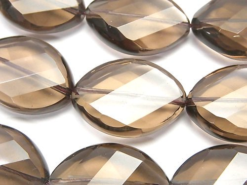 宝石質スモーキークォーツAAA' ツイストオーバルカット25×18×8mm 半連/1連(約34cm)