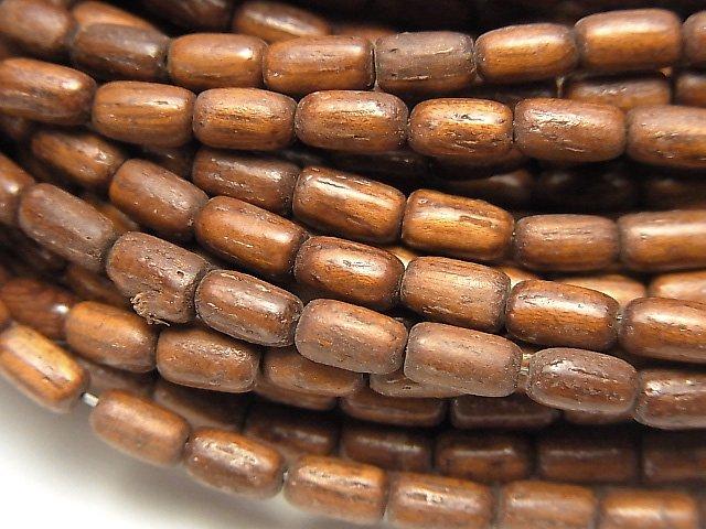 バイヨンウッドビーズ ライス6×3×3mm 1連(約37cm)